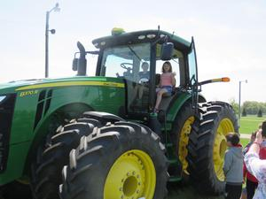 Third graders loved getting a chance to sit in the driver's seat of the big John Deere tractor.