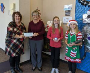Mrs. Gobert accepts $1000 Grant from Penelec representative.