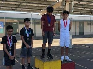 Two 7th grade Lairon students on the podium after receiving their 1st and 2nd place medals.