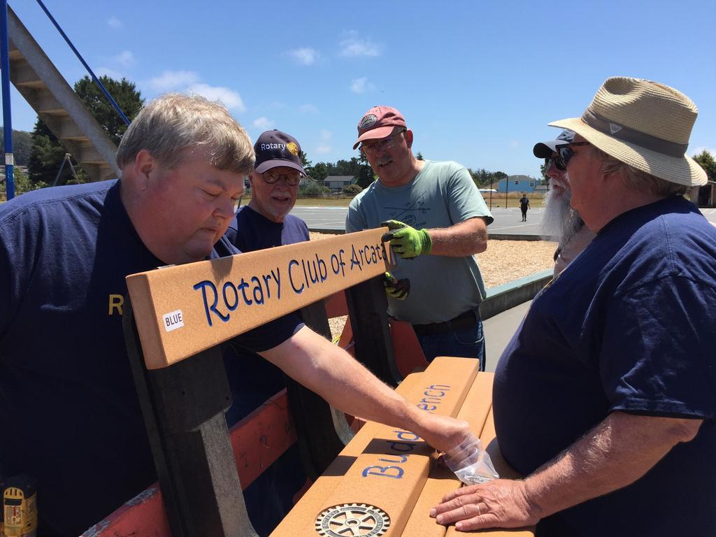 Arcata Rotarians assembling Buddy Bench