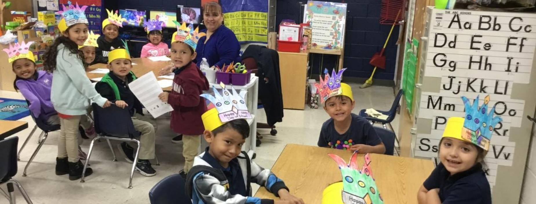 Image of students with 100th day celebration crowns.