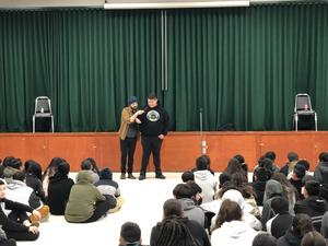 Wayne and a student wowing students at a special magic show.