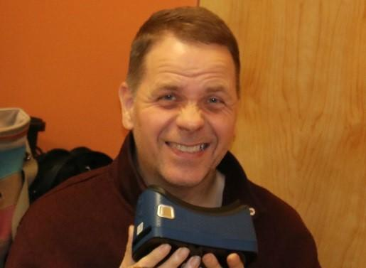 Gentleman holding virtual reality glasses