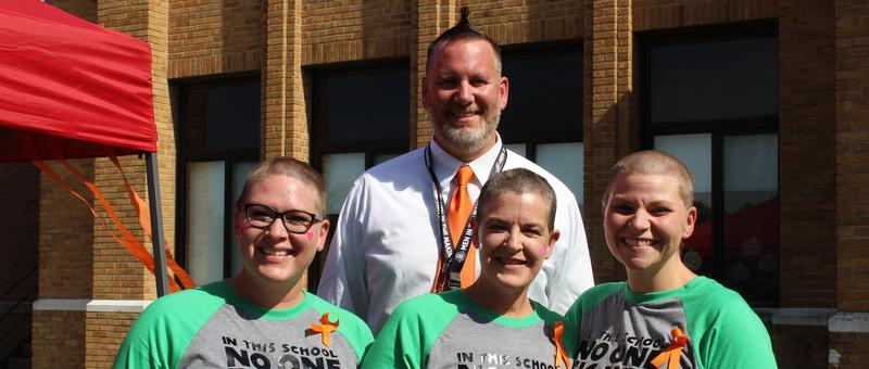Denkmann Principal and Staff Shave their Heads for Student Battling Cancer Featured Photo
