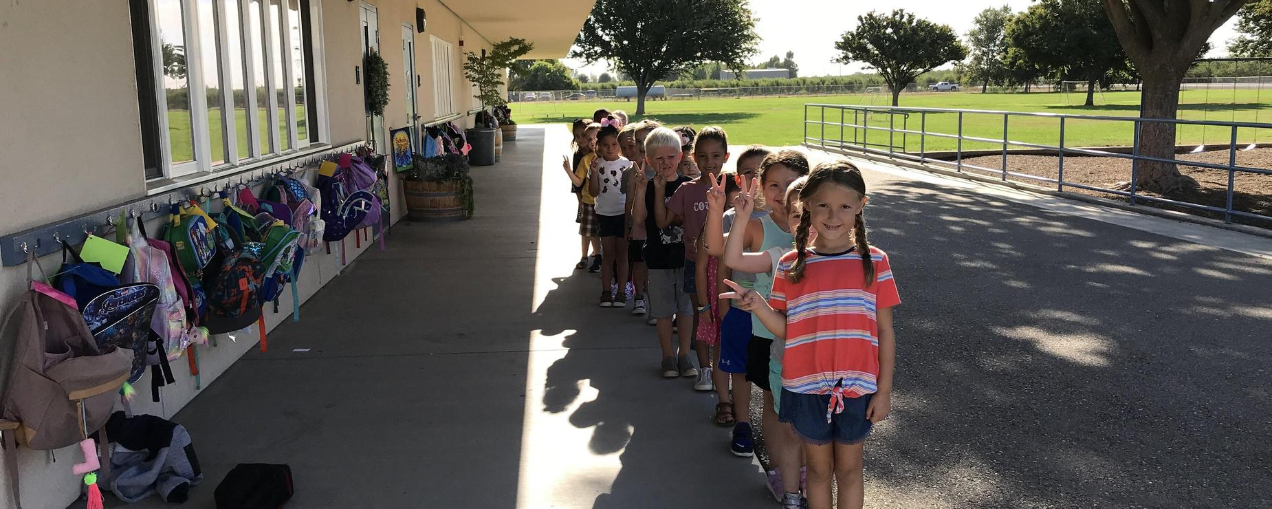 Kindergarteners line up straight