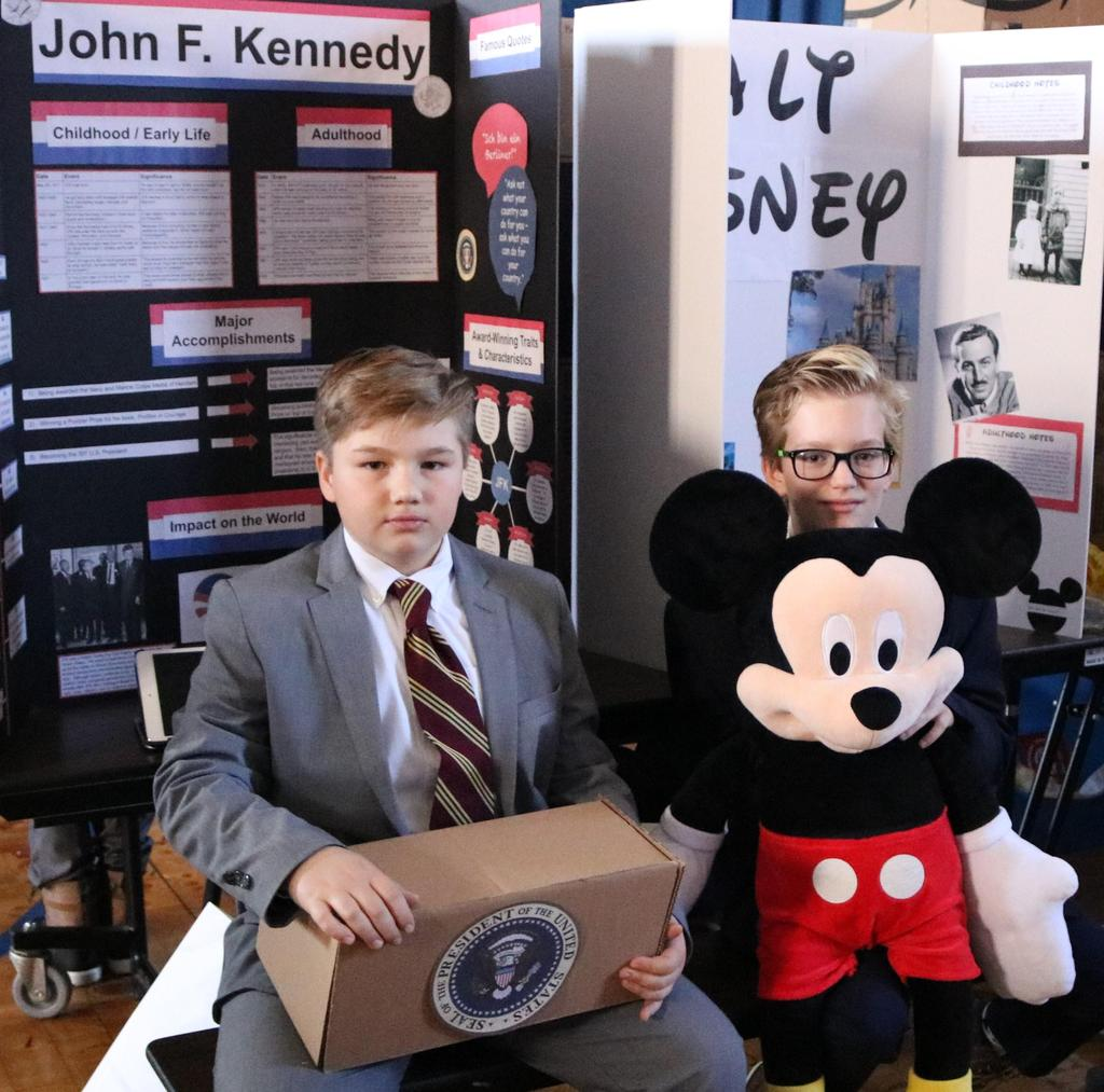 "Photo of two Wilson 5th graders as John F. Kennedy and Walt Disney at annual ""Wax Museum"" event."