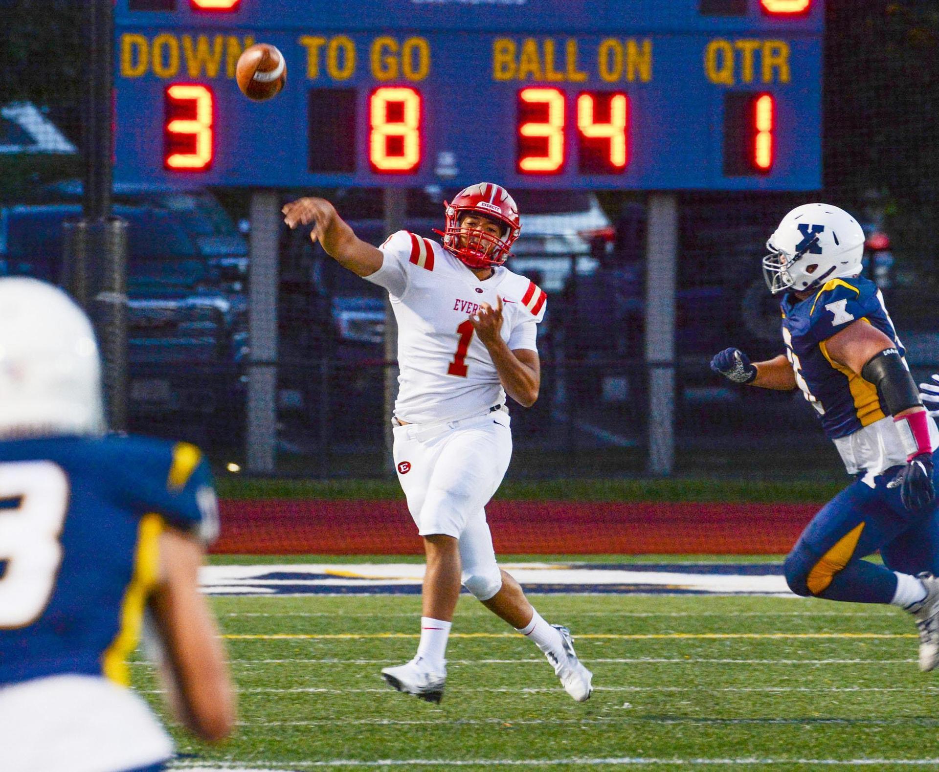 EHS quarterback makes a thrown on the run