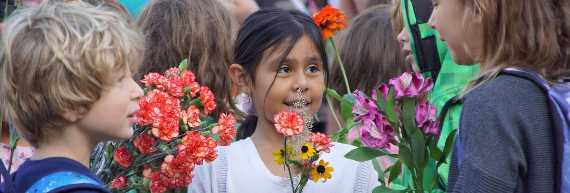 Child with flowers at Wisdom Day