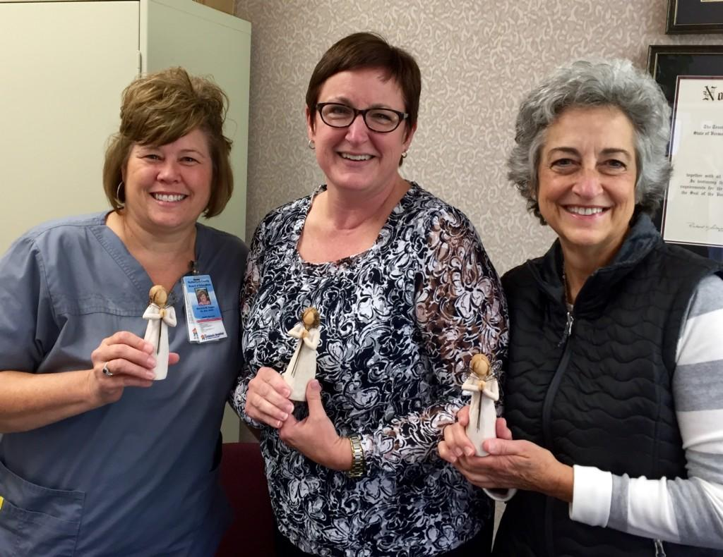 Clinical Nurse Supervisors Marjorie Hogan (left) and Connie Walker (right) with Health Services Director Sarah Delbridge (center). Holiday gifts from the nurses!