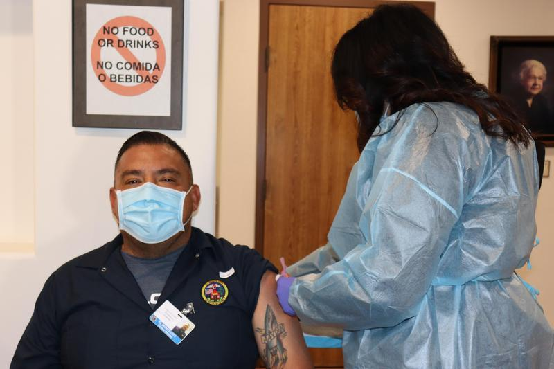 EMCSD staff member receiving vaccine