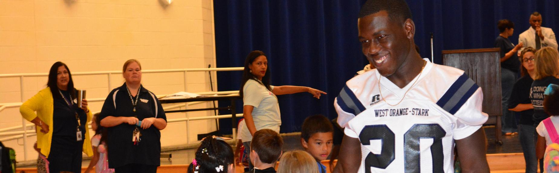 Football player visits Elementary