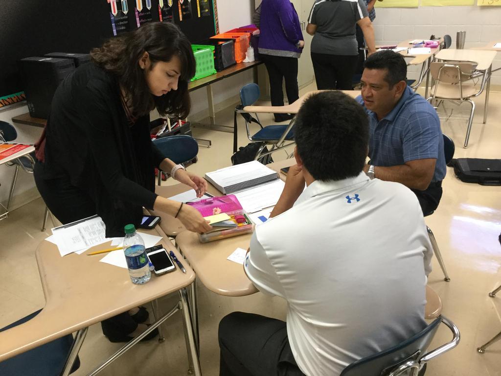 Three Teachers gathered around in desks.
