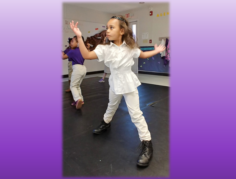 A young girl dancing.