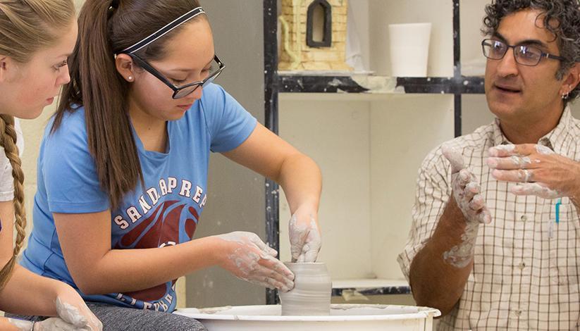 girls with clay teacher