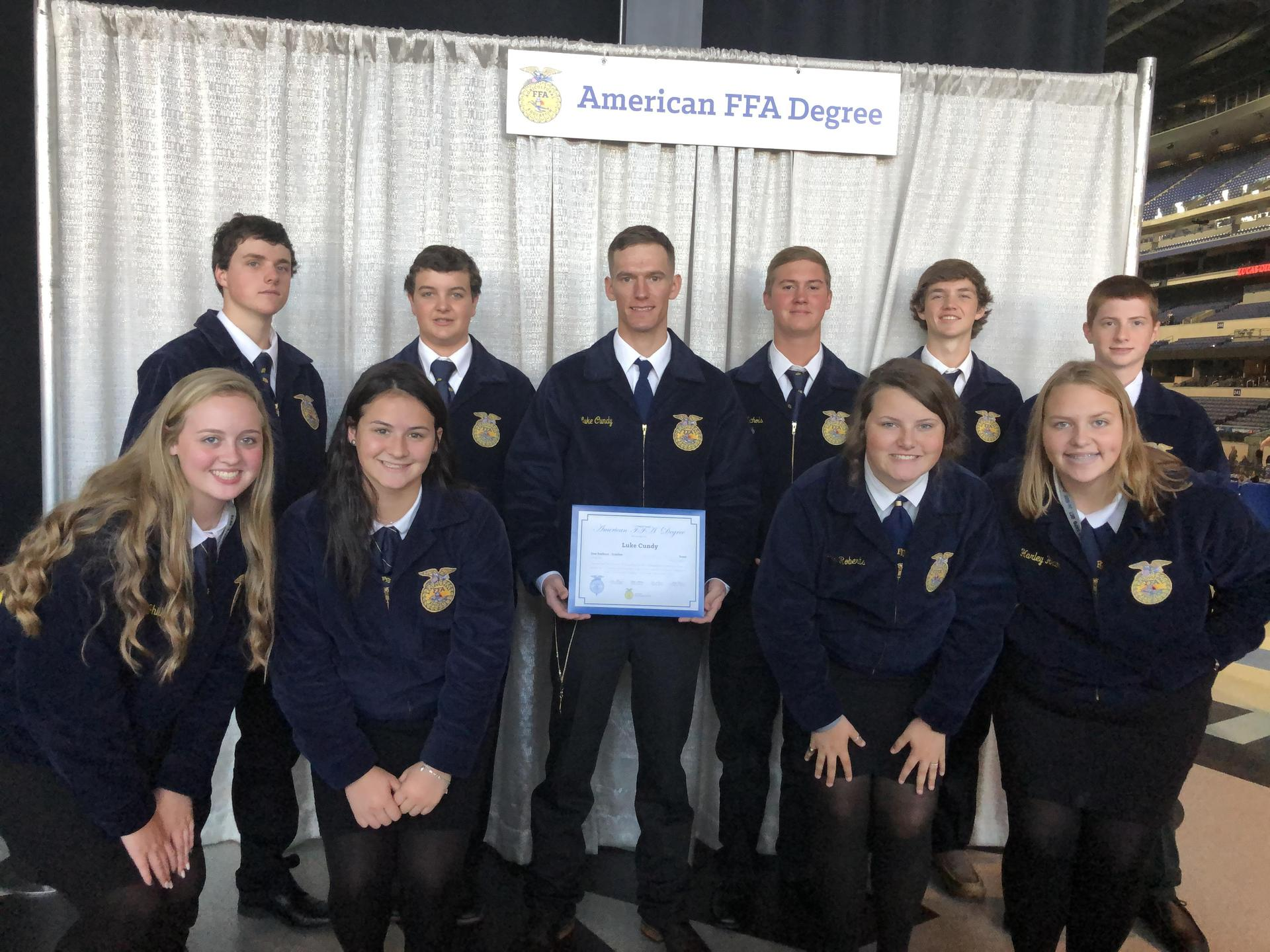 FFA members with Luke Cundy obtaining his American Degree!