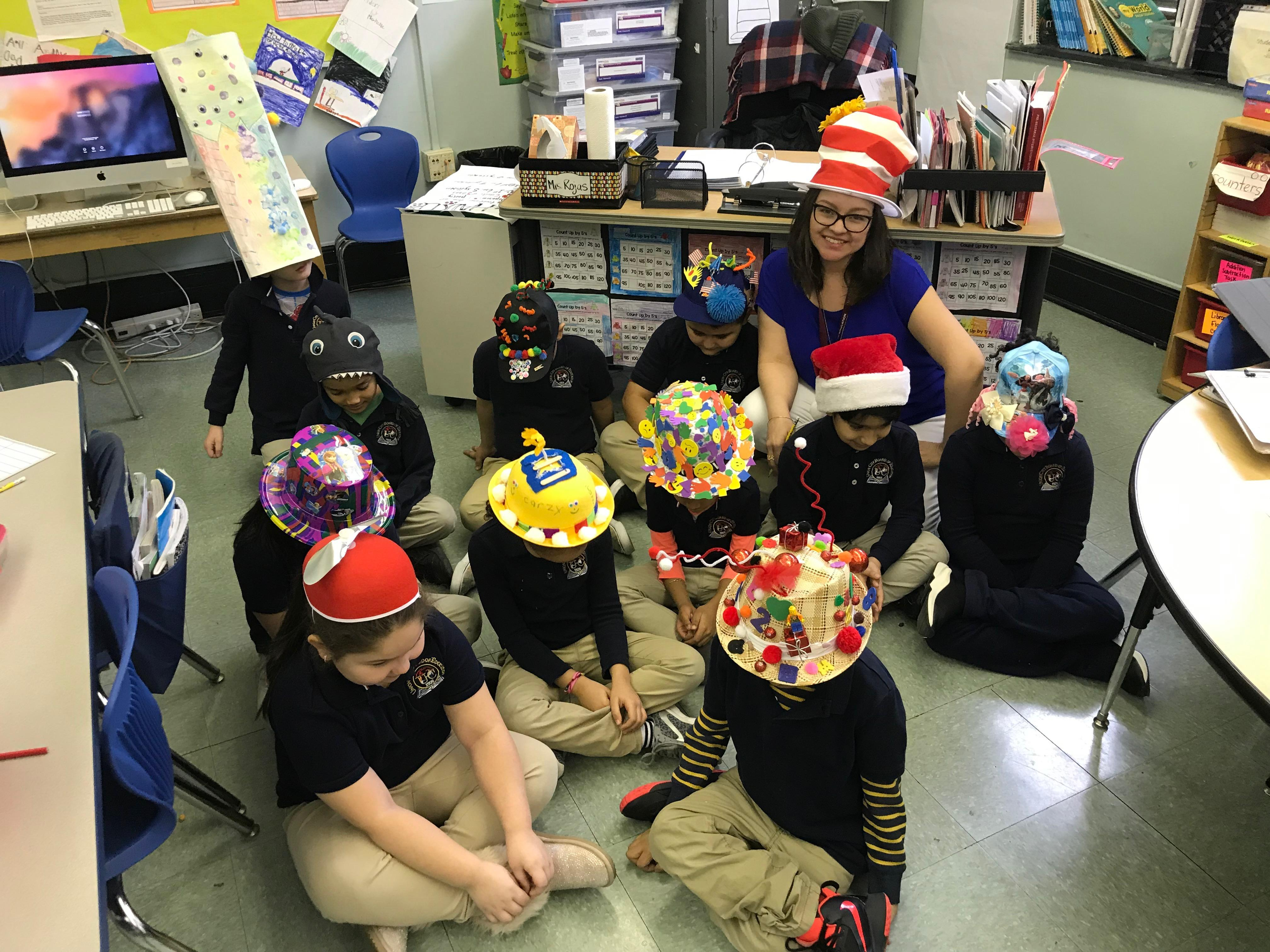 teacher with her class showing off their crazy hats