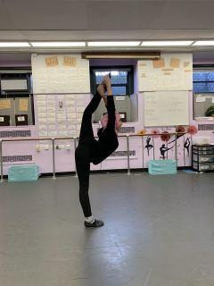 Student stretching before dance practice