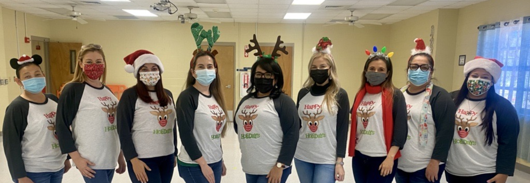 staff with Christmas shirts