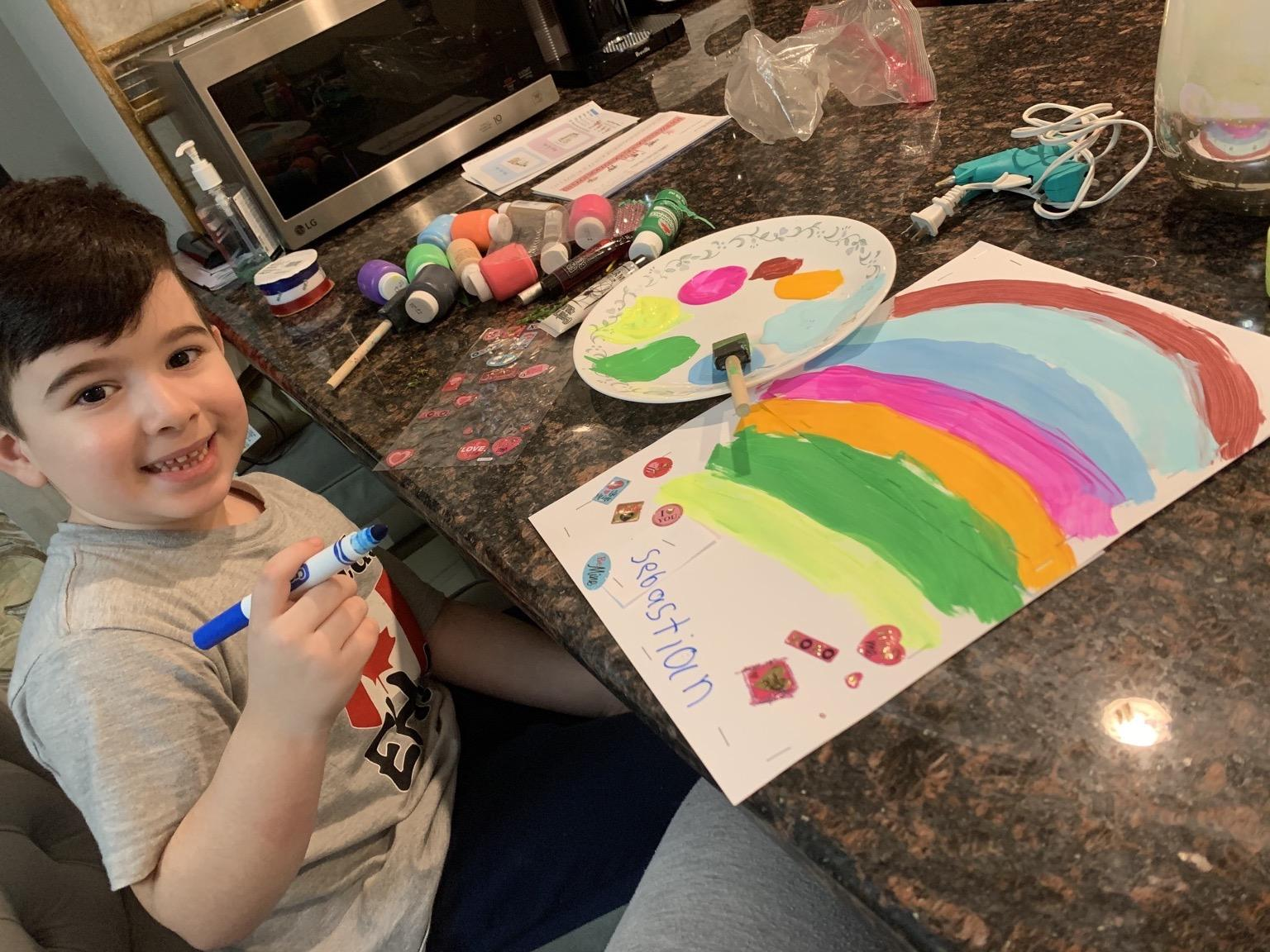 boy drawing rainbow