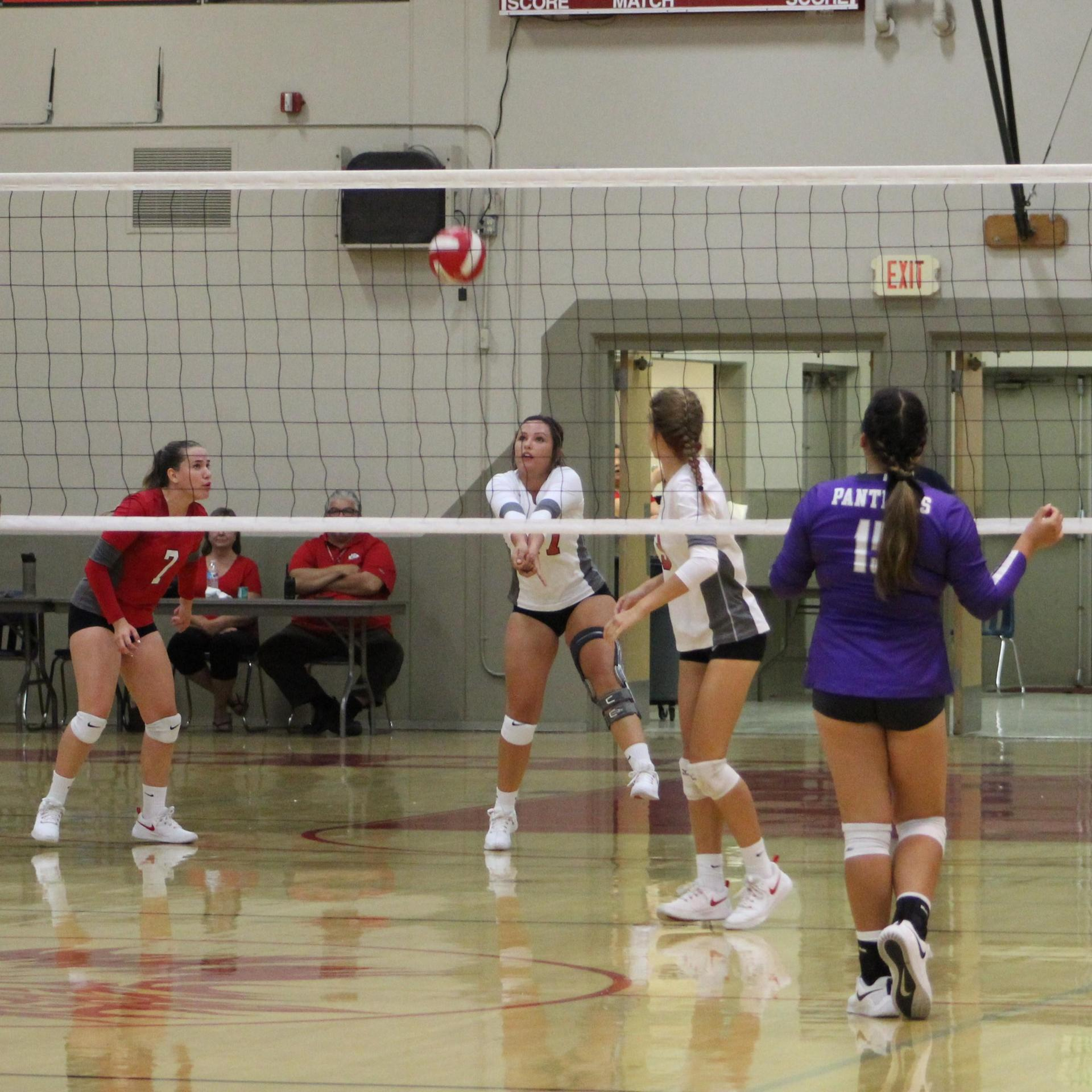 varsity girls playing volleyball against Washington Union