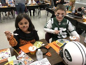 Two students enjoy a Halloween party at Washington School.