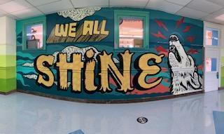 Painting that reads 'We All Shine'