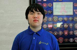 JMS student Eric Wang posing for a picture in a blue JMS Choir polo.