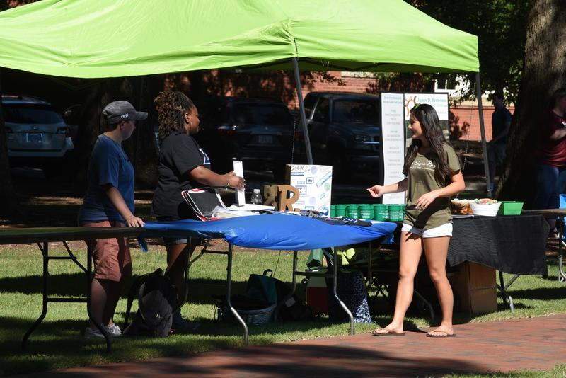 Student at outdoor event table