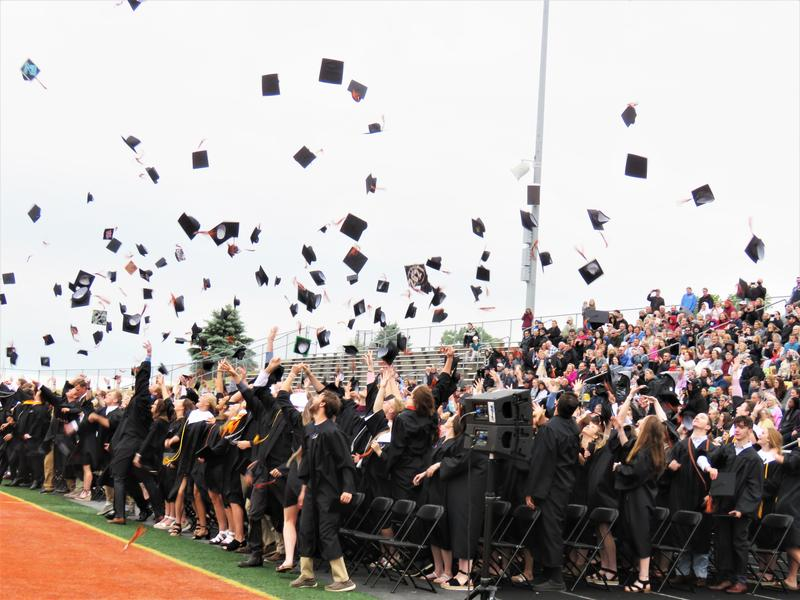 TK Class of 2021 tosses their caps in the air.