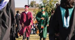 Students walking down graduation lane