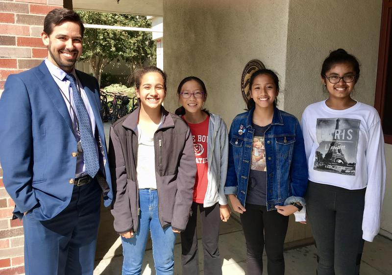 Carlos Kassam-Clay with four SPMS students