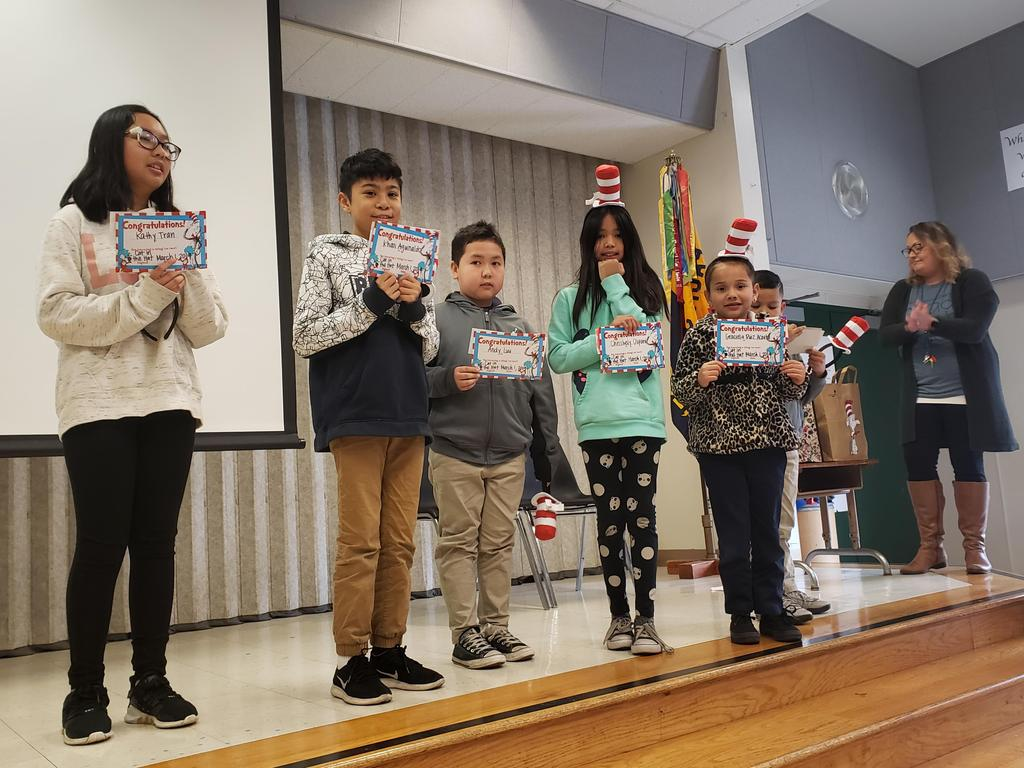winners of bookmark contest pose for a picture