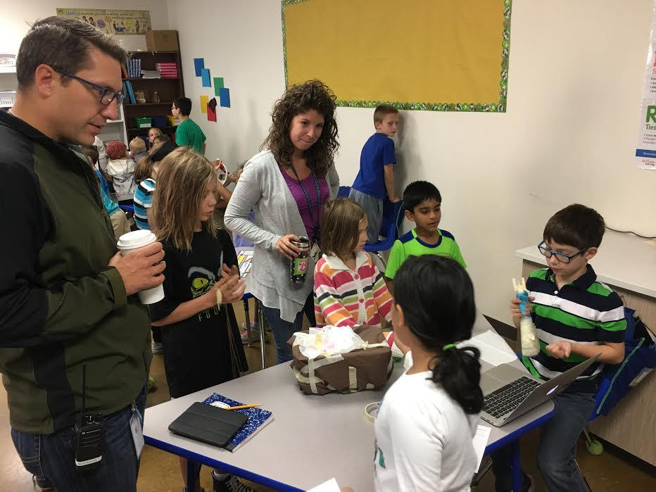 Fourth grade students complete a Problem Based Learning activity that requires them to study the invasive Mountain Pine Beetle and create a way to eliminate the problems they are causing for pine trees in Colorado. Students present their solutions to a representative from the Parks Department.