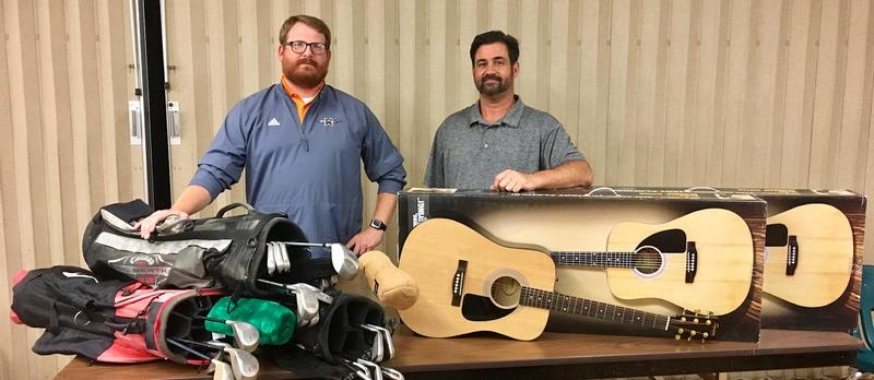 Picture of two men with golf clubs and guitars