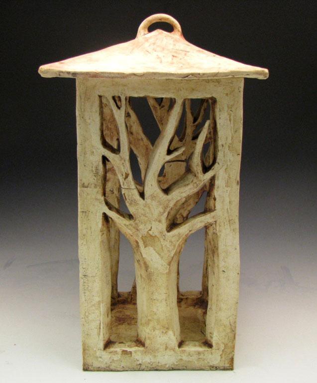 lantern with tree cutout