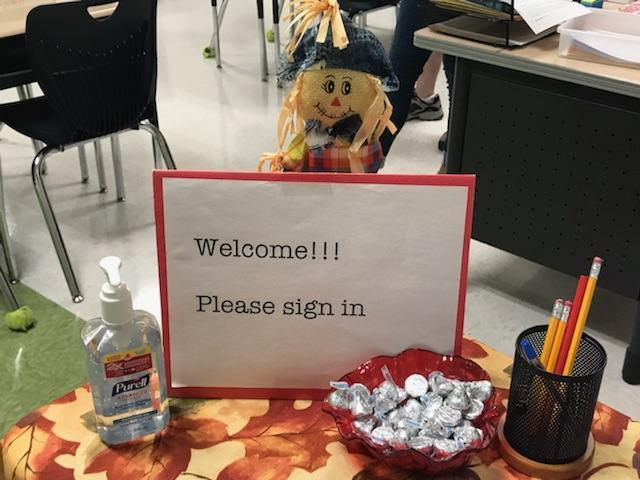 scarecrow welcome sign with goodies