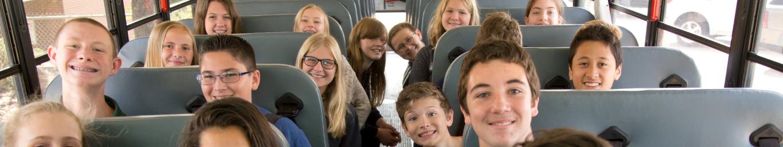Students sitting inside school bus