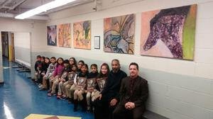 class holding sketch pads with Principal Celebrano and Artist in Residence Kevin Brooks