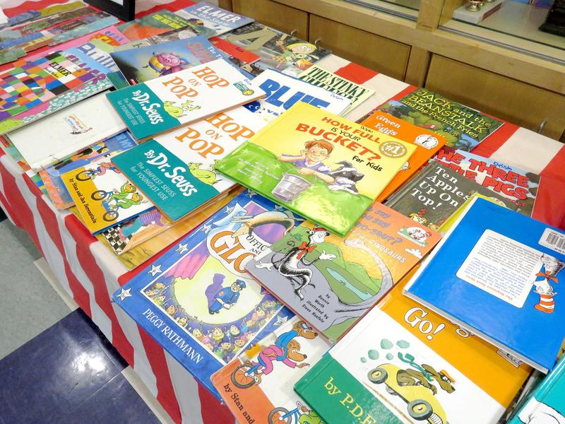 A table covered with books, mostly Dr. Seuss titles