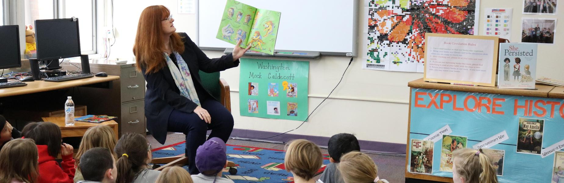 Photo of Westfield Public Schools Superintendent Dr. Margaret Dolan as she reads to 2nd graders at Washington School during Read Across America activities.