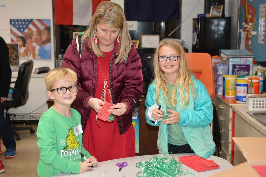 Students and parents making Christmas ornaments on Grinch night