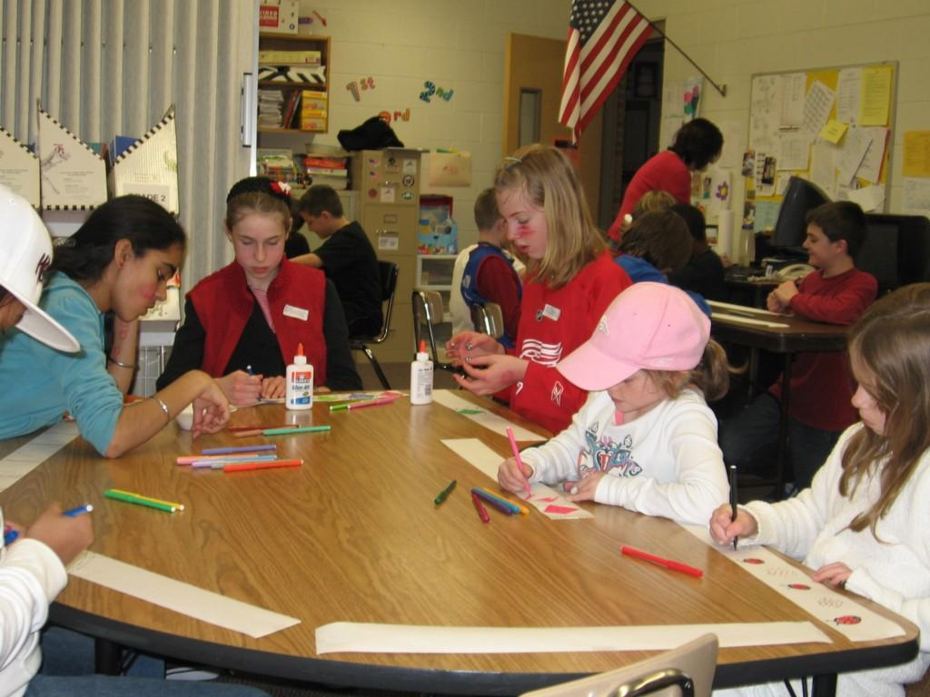 students color at desk