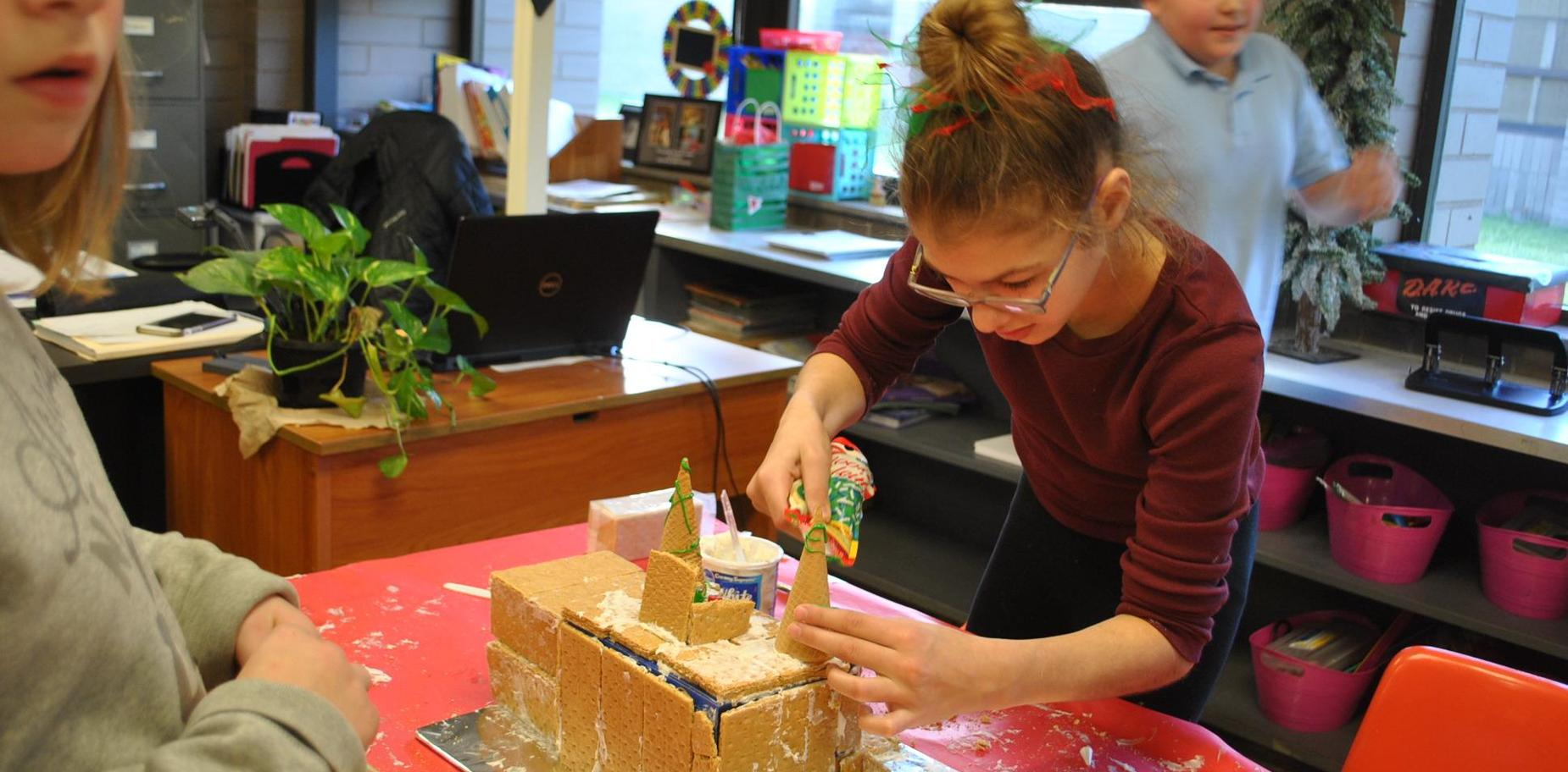 Kids making gingerbread houses