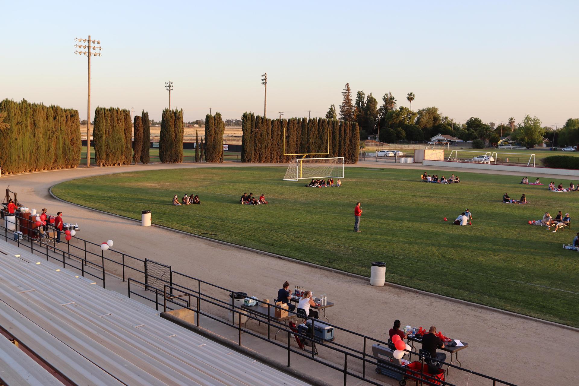 Students and staff in Henry Massaro Stadium during Senior Sunset