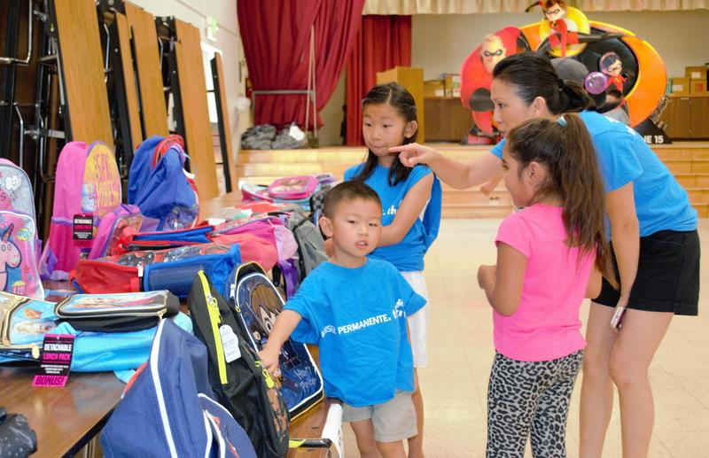 Students picking out a backpack