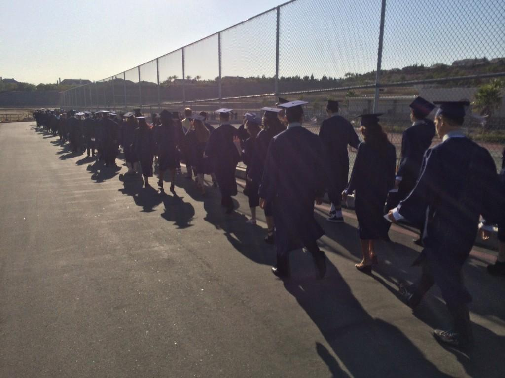 Students trying to walk into the stadium