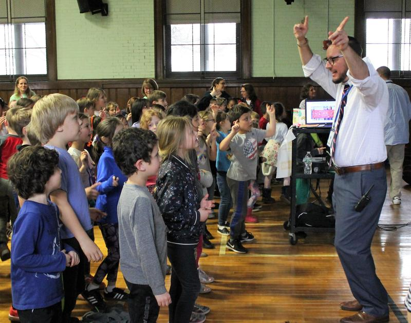 McKinley School principal Marc Biunno dances with students as the school kicks off its annual fundraiser for pediatric cancer research.