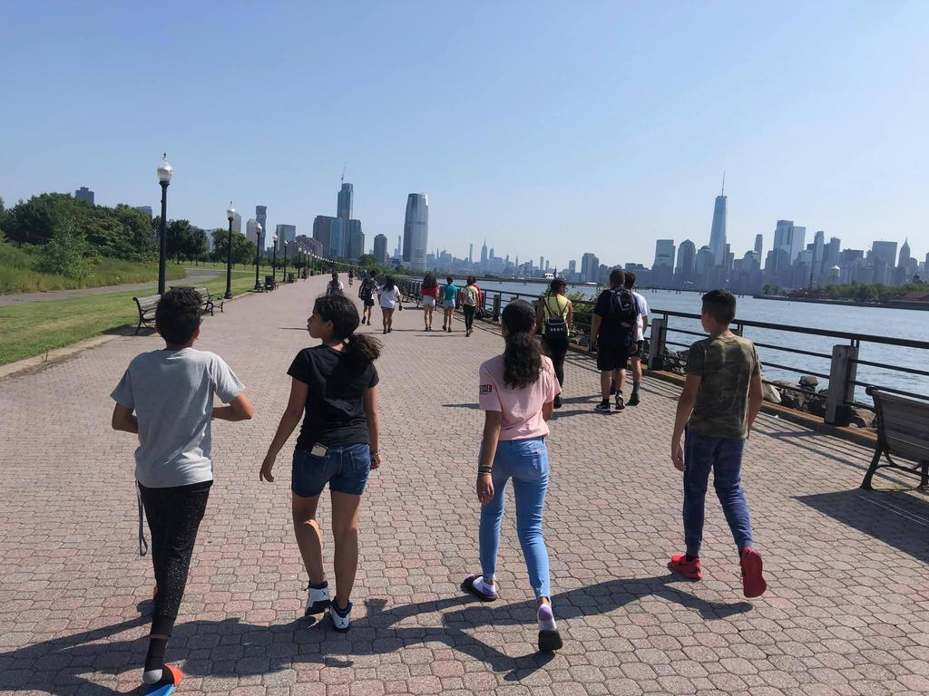 kids walking along the Liberty State Park waterfront