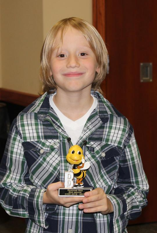 Bentley Rigsby with Reading Bee trophy