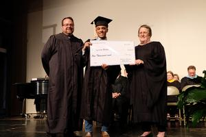 Three people check presentation